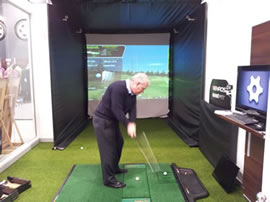 Golfer and Optishot Golf Simulator in action