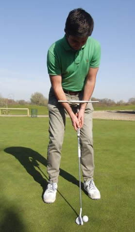 Golfer putting with T-Stroke