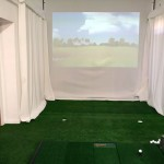 Indoor view of screen with putting turf
