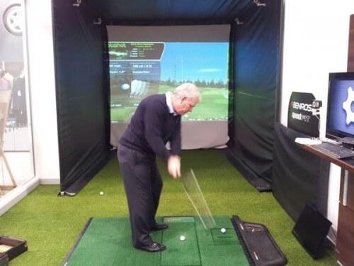 Golfer and Optishot Golf Simulator