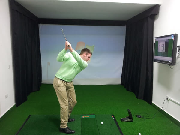 Golfer in the academy room