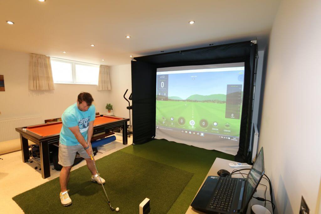 Golf simulator in the basement
