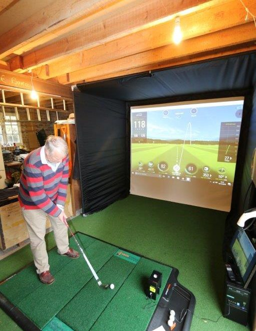 Skytrak home golf simulator enclosure golf swing systems for Golf simulator room dimensions