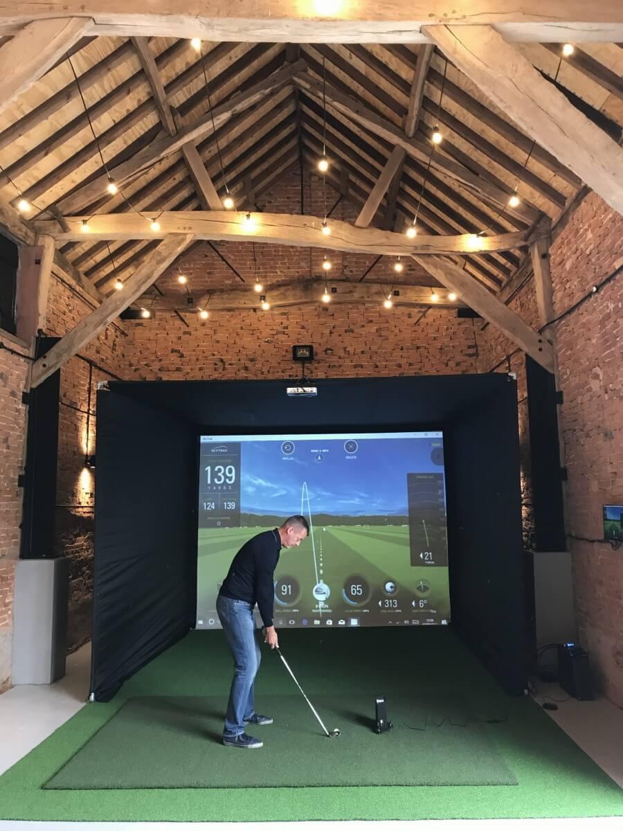 Skytrak launch monitor golf simulator golf swing systems for Golf simulator room dimensions