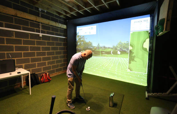 Golf simulator set up in a garage